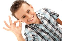 Cute kid making OK sign. Adorable kid making OK sign, isolated on white background Stock Photos