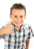 Cute kid making thumbs up sign. Adorable boy making thumbs up sign, isolated on white background Stock Photo