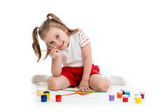 Cute kid painting Stock Images
