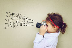 Cute kid photographer holding vintage camera during playing activity. inspiration concept. Royalty Free Stock Photo