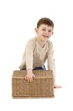 Cute kid playing with basket smiling Stock Photo