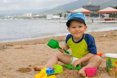 Cute kid playing on the beach Royalty Free Stock Photography