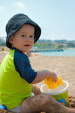 Cute kid playing on the beach Royalty Free Stock Images
