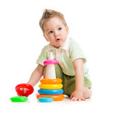 Cute kid playing colorful tower Stock Images