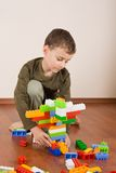 Cute kid playing with cubes Royalty Free Stock Photography