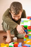 Cute kid playing with cubes Royalty Free Stock Photo