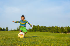 Cute kid is playing football. Stock Photography