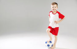Cute kid playing the football Stock Images