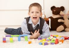 Cute kid playing at home Royalty Free Stock Images