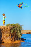Cute kid playing with kite Stock Images