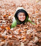Cute kid playing outdoor Royalty Free Stock Photos