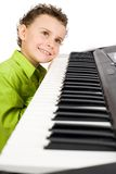Cute kid playing piano Royalty Free Stock Image