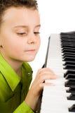 Cute kid playing piano Royalty Free Stock Photo