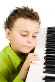 Cute kid playing piano Royalty Free Stock Photos