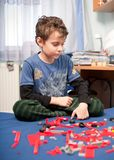 Cute kid playing with plastic blocks Stock Image