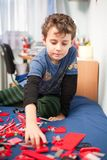 Cute kid playing with plastic blocks Royalty Free Stock Images