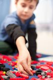 Cute kid playing with plastic blocks Stock Photography