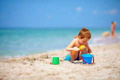 Cute kid playing on the sea beach Stock Photo