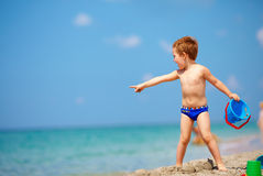 Cute kid playing on the sea beach Royalty Free Stock Photos