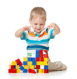Cute kid playing toy blocks Royalty Free Stock Images