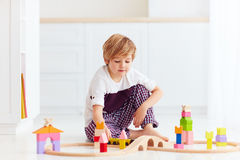 Cute kid playing with toy railway at home Stock Photography