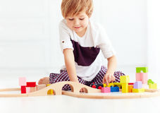 Cute kid playing with toy railway at home Royalty Free Stock Photos