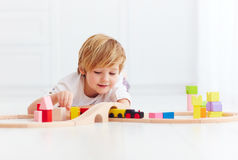 Cute kid playing with toy railway at home Royalty Free Stock Photo