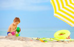 Cute kid playing toys on the beach Royalty Free Stock Photography