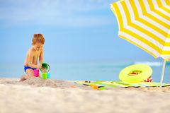 Cute kid playing toys on the beach Stock Photography