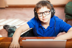 Cute kid playing video games Stock Photo