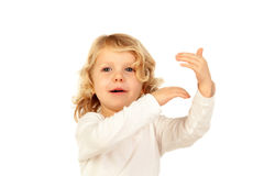 Cute kid pointing with his finger Royalty Free Stock Photos