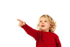 Cute kid pointing out with his finger. Isolated on white background Royalty Free Stock Images