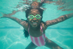 Cute kid posing underwater in pool Stock Image