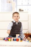 Cute kid proud of building toys Stock Images