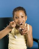 Cute kid with pudding stock photography