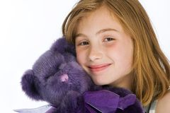 Cute kid with a Purple Teddy Bear Stock Photo