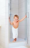 Cute kid ready to wash himself in shower Royalty Free Stock Image
