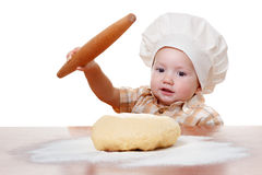 Cute kid rolls cook pizza dough. Isolated on white background Royalty Free Stock Photos
