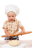Cute kid rolls cook pizza dough. Isolated on white Stock Image