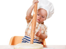Cute kid rolls cook pizza dough Royalty Free Stock Photo