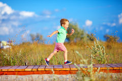 Cute kid running the field Stock Photo