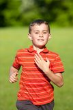 Cute kid running on grass Stock Images