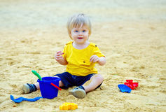 Cute kid in the sandpit Stock Photography