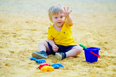 Cute kid in the sandpit Royalty Free Stock Images