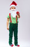 Cute kid santa claus in cap and beard Stock Photos