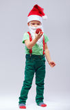 Cute kid santa claus in cap and beard Stock Photography