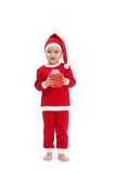 Cute kid in santa costume with gift Stock Photography