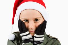 Cute kid with Santa hat Stock Photo
