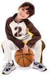 Cute kid sitting on the ball. Cute kid stylishly sitting on the ball, isolated background Royalty Free Stock Image