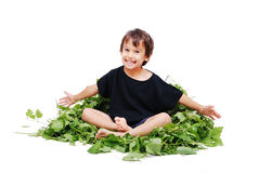 Cute kid sitting on leafs Royalty Free Stock Photography